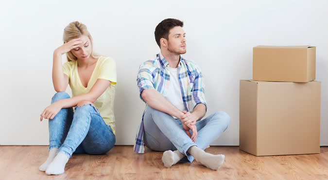 married couple divorcing with moving boxes